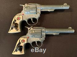 2 Hubley Western Toy Cap Guns withDouble Leather Holster & White Bullets Vintage