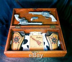 2 Nichols Stallion 45 Die Cast Cap Guns, ca. 1950 + Holsters, Case, Manual & More