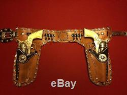 Beautiful vintage studded Roy Rogers double holster Hubley cap guns