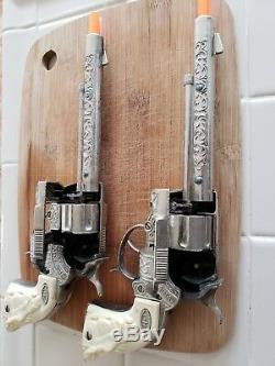 Gene Autry 44 Cap Guns with leather holster