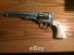 HUBLEY VINTAGE 1950'S COLT 45 CAP GUN withbullets plus plastic advertising plaque