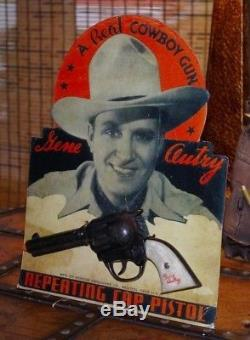 Kenton Gene Autry cap gun on a great looking reproduction store display