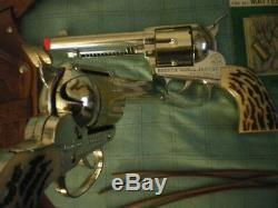 Mattel shootin' shell. 2 gun holster set