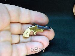 Miniature cap gun Colt Derringer 2mm pinfire gun fob gun berloque toy gun