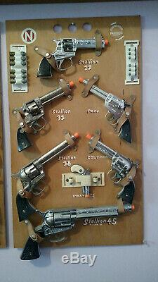 Nichols Cap Guns Display Board with guns