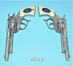 VINTAGE 1950's TWIN WAGON TRAIN GUNS With WHITE GRIPS, & GENUINE LEATHER HOLSTERS