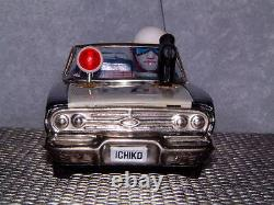 VINTAGE ICHIKO TIN FRICTION DRIVEN POLICE CAR WithROTATING GUN & SIREN. WITH BOX