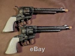 Vintage Halco Dbl. Holster set with two matching bronze finish cap guns 1955-60